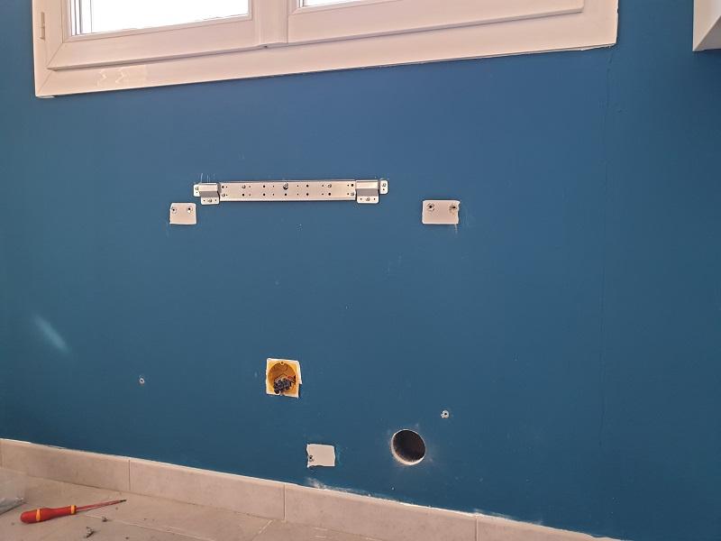 Perçage du mur pour l'installation d'une climatisation Mitsubishi